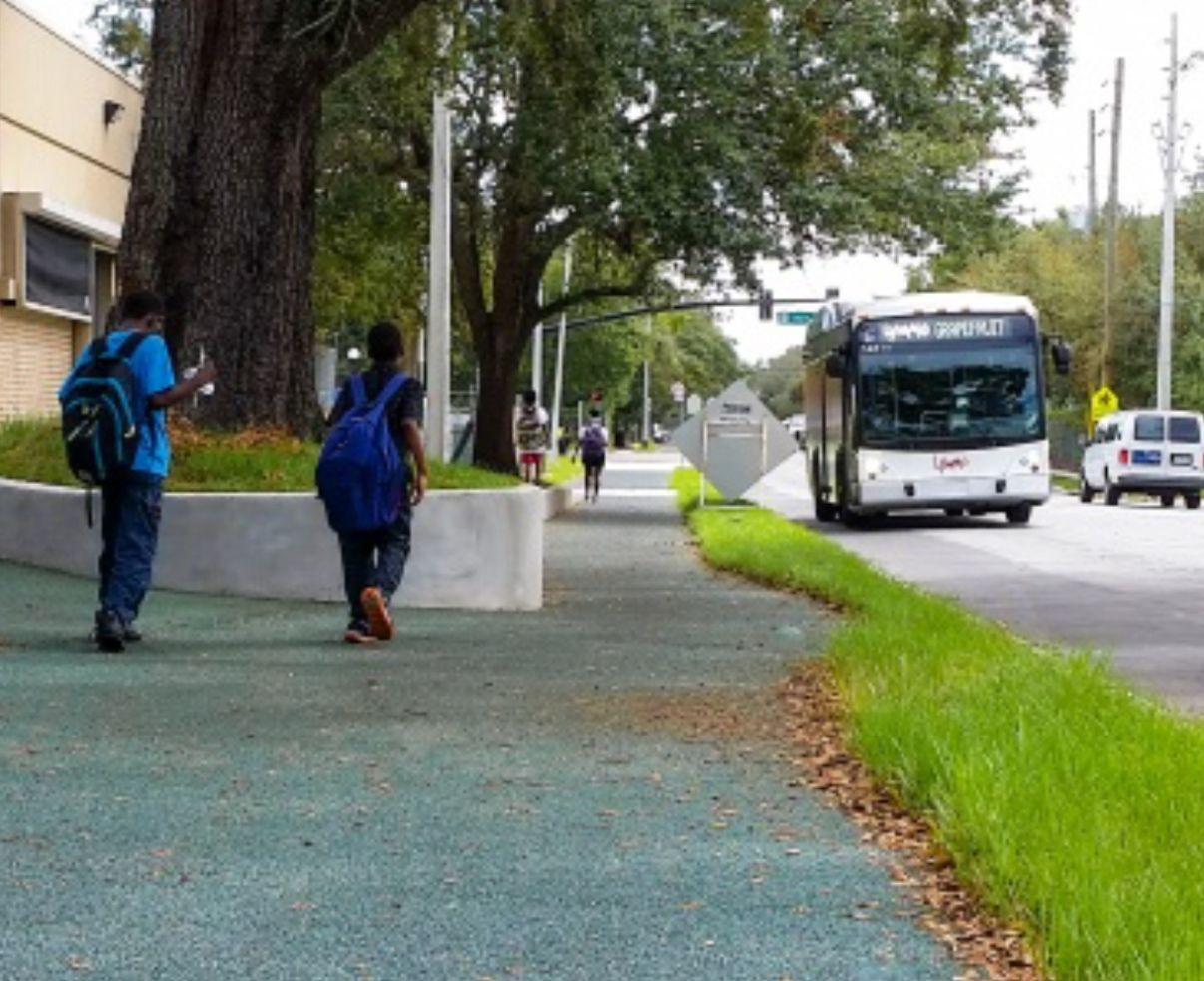 Academic Center for Excellence students walk to school safely on Porous Pave