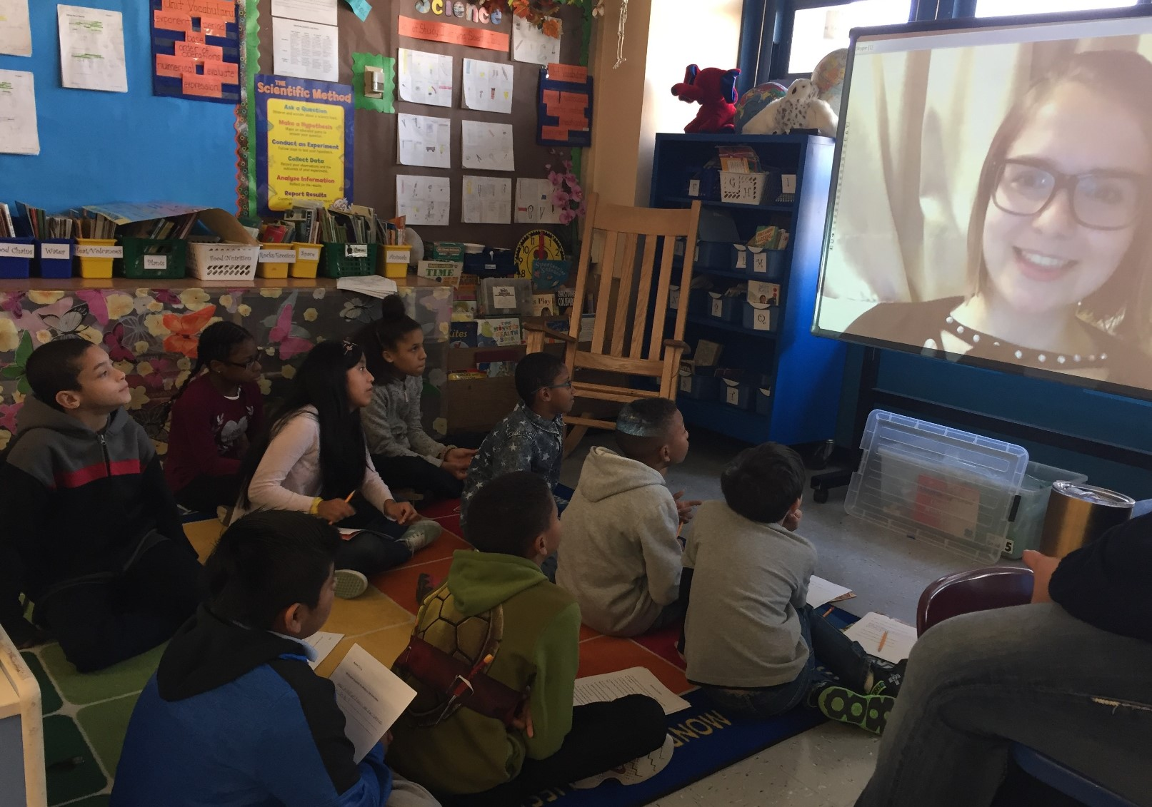 A Reach the World classroom video conferences with their traveler